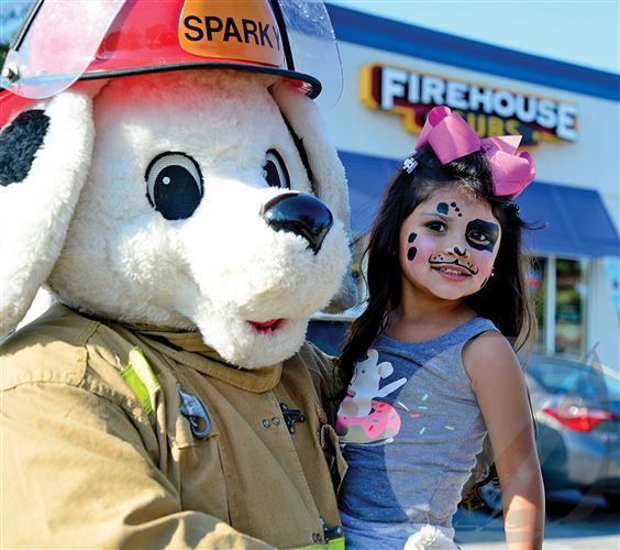 Sparky mascot with child